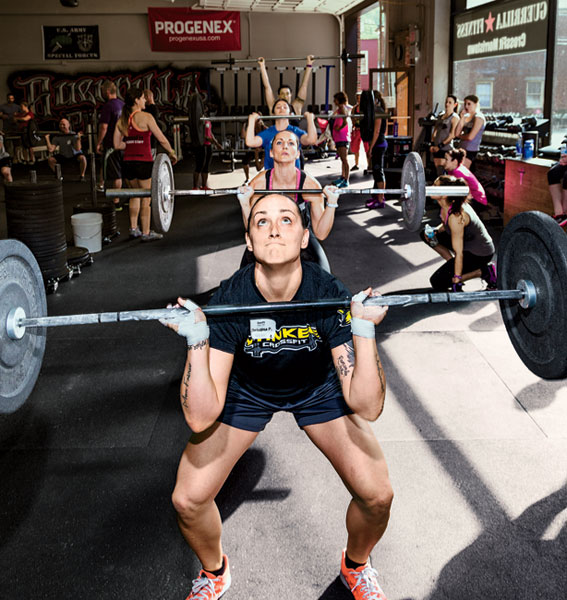 <strong>CERTIFIABLE</strong> CrossFitters do thrusters as part of a training seminar at CrossFit Morristown in Morristown, New Jersey. If you survive a two-day course, you can be certified to teach CrossFit and open your own place.
